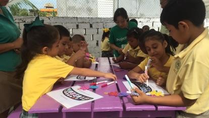 Youth development volunteers run an educational activity for the children in Belize.